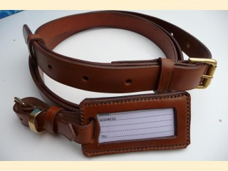 Suitcase strap and label